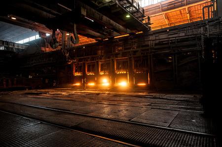 ferrous: Steelworker near the working open hearth furnace