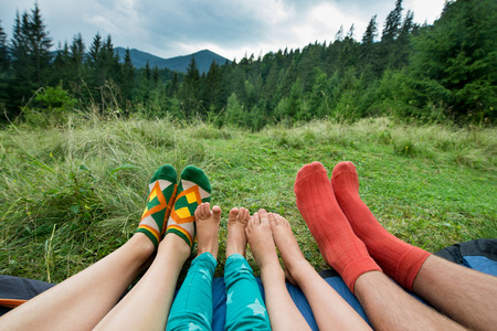 legs of a family of four outdoors