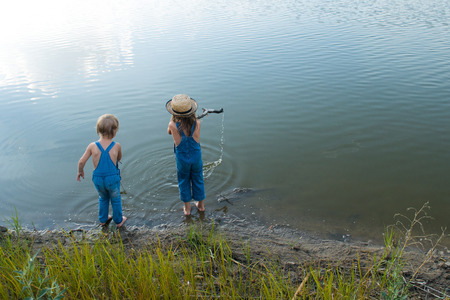 Two children play near the river