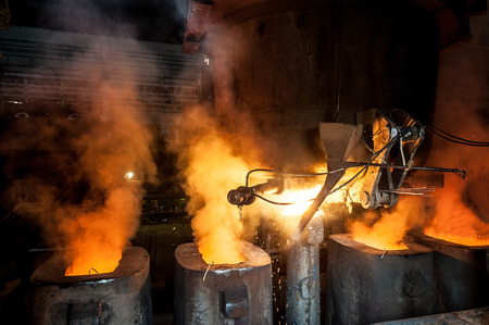 Tank pours the liquid steel in the molds Reklamní fotografie