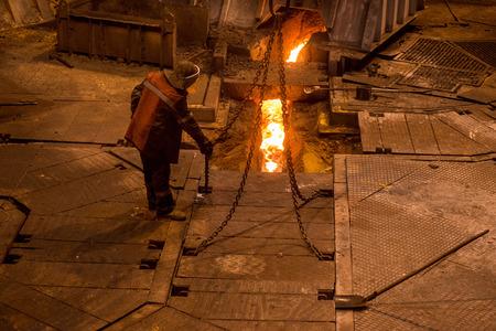 Steelworker near a blast furnace Stok Fotoğraf
