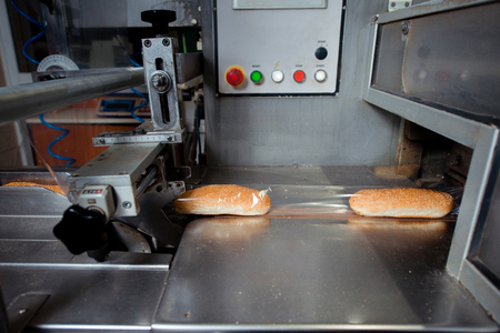 Bread packaging process on a conveyor belt