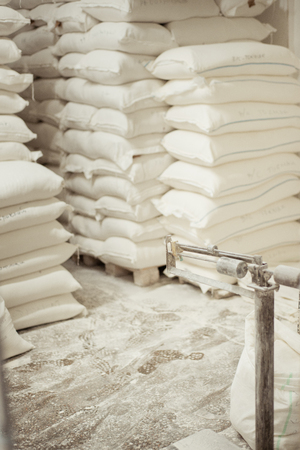 Sacks of flour in the bakery warehouse Stock Photo