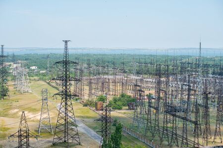 A lot of high-voltage power lines on the territory of the Thermal Power Plant outdoor
