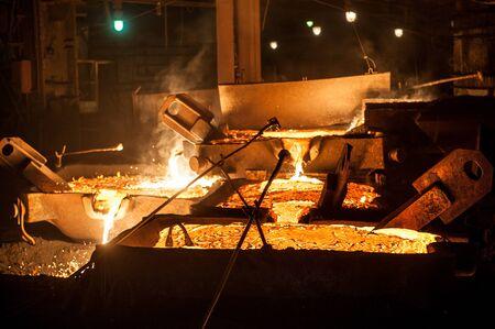 Pouring liquid titanium slag from arc furnace Foto de archivo