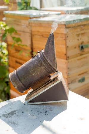 smoke tool in an apiary closeup