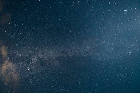 Milky way in the night starry sky Фото со стока