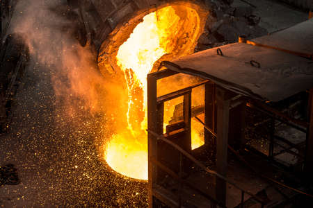 Tank pours liquid metal at the steel mill