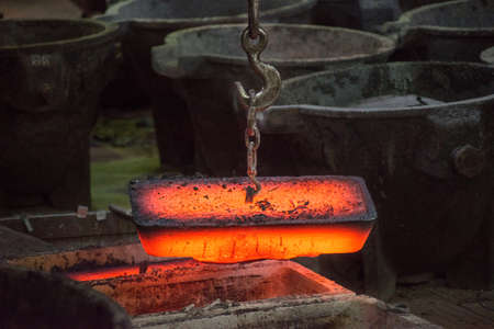 Plate of hot metal. The production process at a steel mill