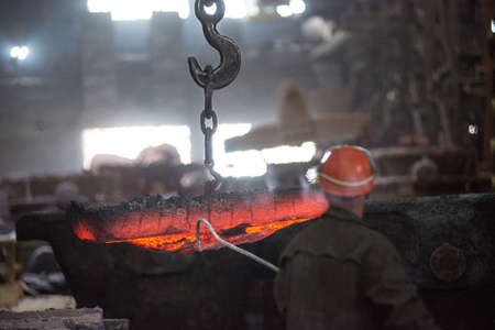 Steelworker at work at a steel mill Standard-Bild