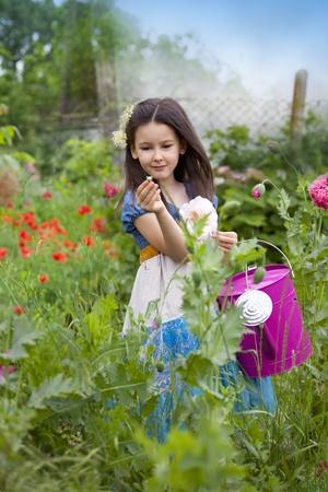 Sweet little girl in the spring garden