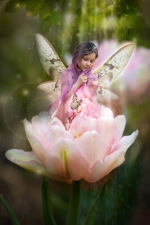 Sweet little fairy in pink tulip photo