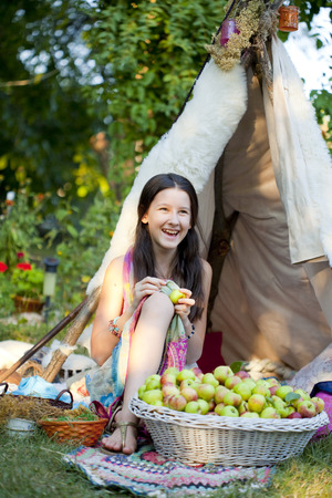 smilley teenage girlin a front of summer tent