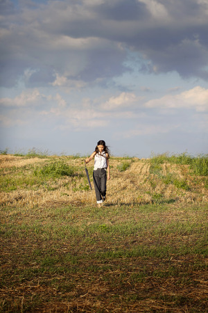 teenager girl on the rural road