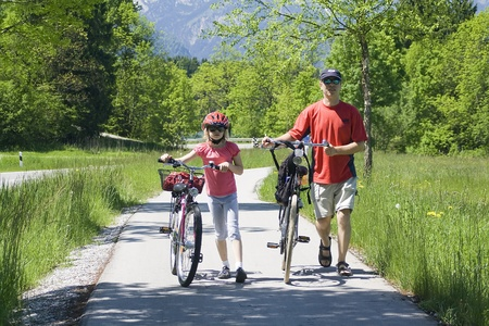 a family havig a weekend excursion on their bikes photo