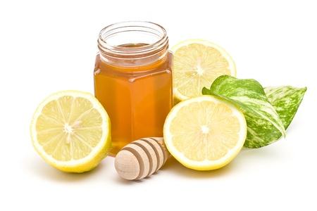 golden honey: jar of honey and lemon Stock Photo