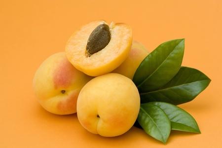 apricots on orange background Stock Photo - 12706570