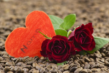 red roses and paper hearts on coffee beans Stock Photo - 12722002