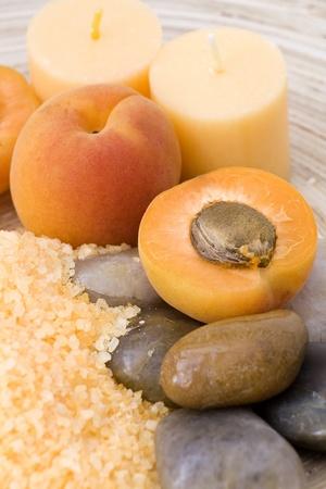 peaches bath with bath salt, stones and fresh fruits photo