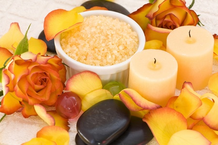 bath salt, massage stones, rose petal and candles photo