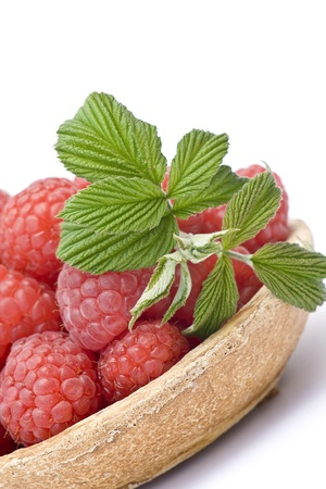 fresh raspberries on a plate, on white background photo