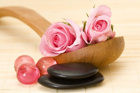 spa stones, oil bath pearls and roses photo