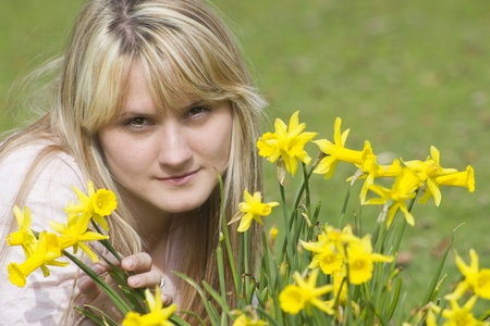 beautiful young woman with flowers on a warm spring day  Stock Photo - 13069383