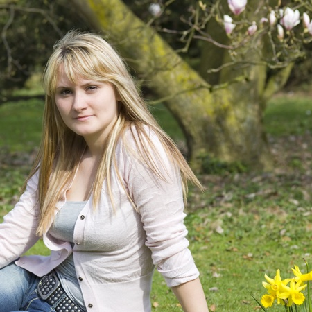 young woman in the park on a warm spring day photo