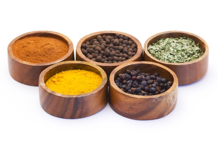 five bowls of spices isolated on white Imagens