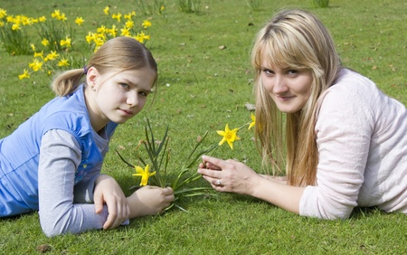 young woman and little girl in the park on a warm spring day Stock Photo - 13181028