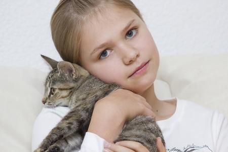 Portrait of child with kitten photo