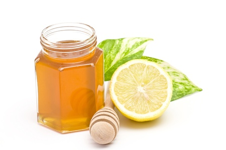 jar of honey and lemon Stock Photo