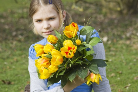 horozontal: Little girl with tulips bouquet