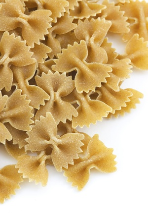 processed grains: whole grain farfalle pasta close up Stock Photo