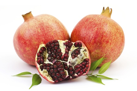 fresh pomegranate on white