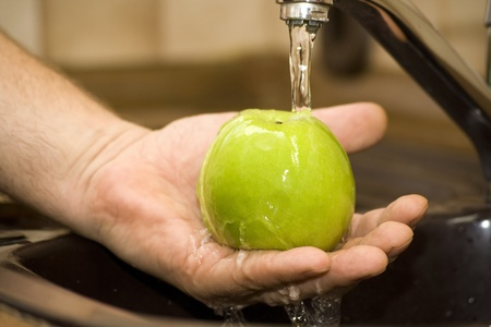 to wash up an apple Stock Photo - 13542964