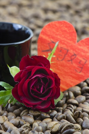 cup of coffee, red rose and heart photo