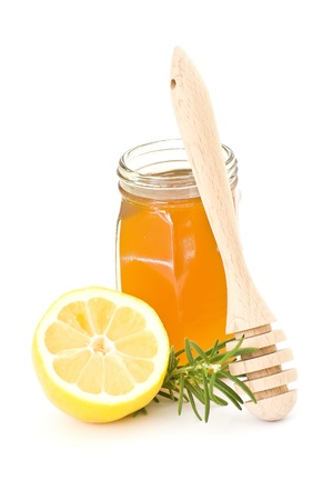 drizzler: jar of honey, lemon and wooden drizzler