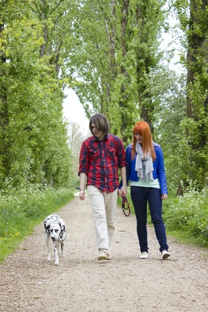 young couple people and dog Stock Photo - 13584424