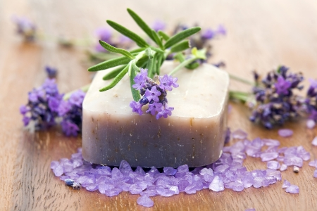 natural product: bar of natural soap and lavender flowers