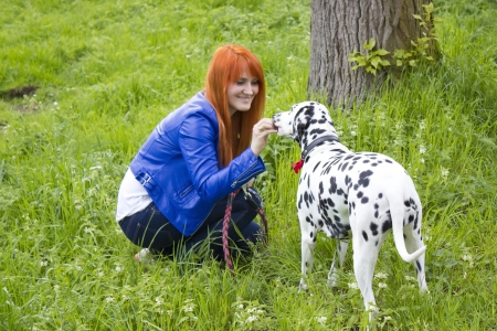 A beautiful woman and her dog Stock Photo - 13805366