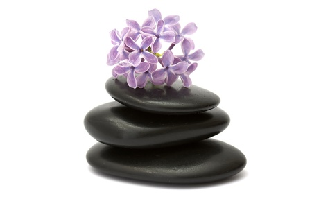 lilac flowers and massage stones photo