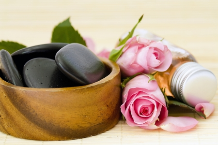 spa stones, bath oil and roses photo
