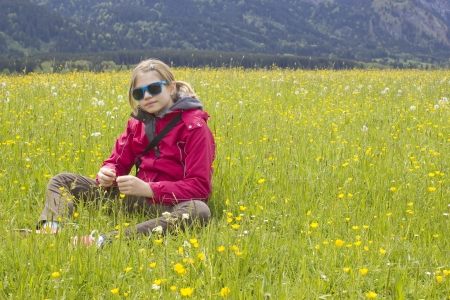 little girl in a meadow photo