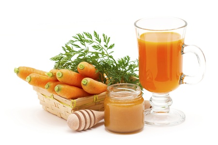 glass of fresh carrots juice with honey Standard-Bild