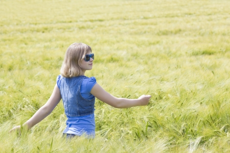 young girl in the field of barley  photo