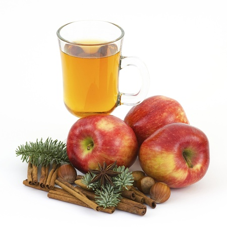 glass of apple juice, fresh apples and spices photo