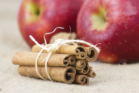 apple and cinnamon: cinnamon sticks and apples Stock Photo