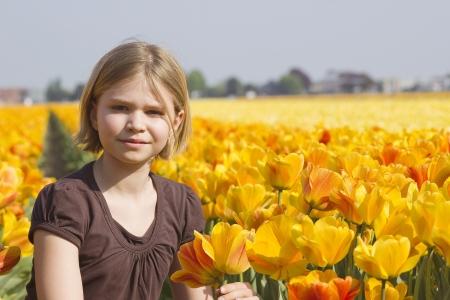 dutch girl: little girl in tulips field