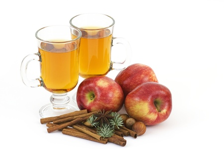glass of apple juice, fresh fruits and spices photo